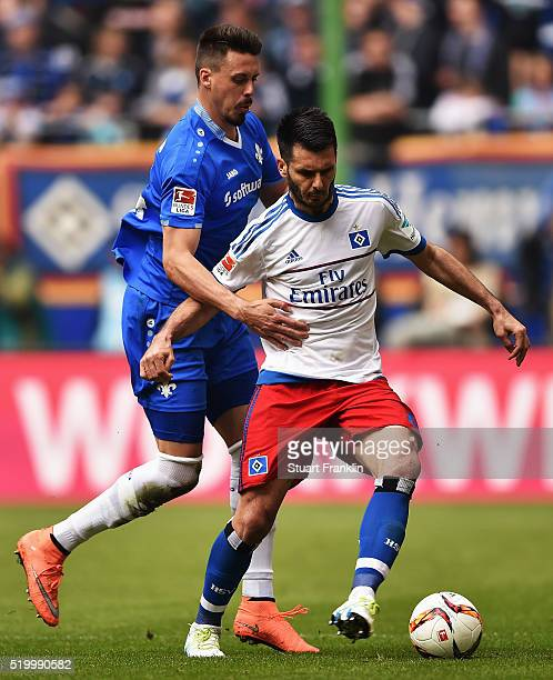 Emir Spahic of Hamburg is challenged by Sandro Wagner of Darmstadt during the Bundesliga match between Hamburger SV and SV Darmstadt 98 at...