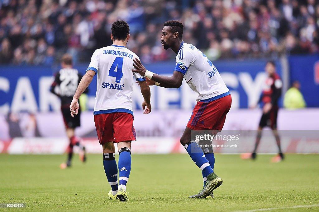 Emir Spahic of Hamburger SV receives instructions from team mate Johan Djourou during the Bundesliga match between Hamburger SV and Bayer Leverkusen at Volksparkstadion on October 17, 2015 in Hamburg, Germany.