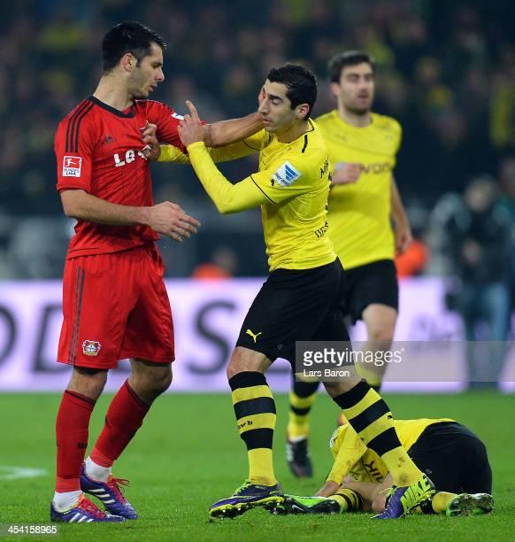 Emir Spahic of Leverkusaen hits Henrikh Mkhitaryan of Dortmund during the Bundesliga match between Borussia Dortmund and Bayer Leverkusen at Signal...
