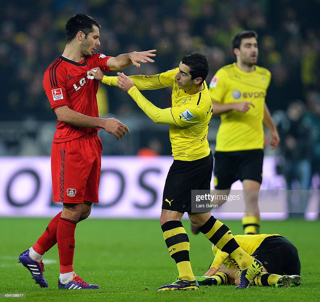 Emir Spahic of Leverkusaen hits <a gi-track='captionPersonalityLinkClicked' href=/galleries/search?phrase=Henrikh+Mkhitaryan&family=editorial&specificpeople=6234732 ng-click='$event.stopPropagation()'>Henrikh Mkhitaryan</a> of Dortmund during the Bundesliga match between Borussia Dortmund and Bayer Leverkusen at Signal Iduna Park on December 7, 2013 in Dortmund, Germany.