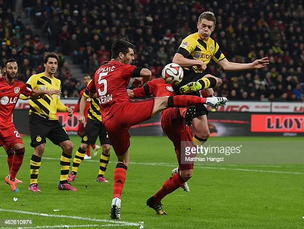 Emir Spahic of Leverkusen and Matthias Ginter of Dortmund compete for the ball during the Bundesliga match between Bayer 04 Leverkusen and Borussia...