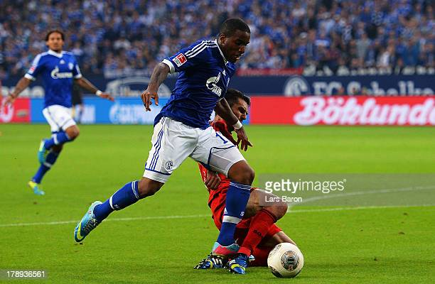 Emir Spahic of Leverkusen challenges Jefferson Farfan of Schalke during the Bundesliga match between FC Schalke 04 and Bayer Leverkusen at...