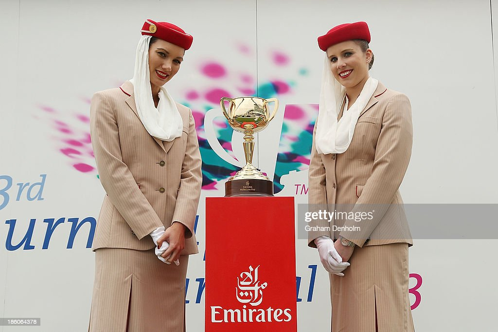Emirates air hostesses pose with the Emirates Melbourne Cup at the 2013 Melbourne Cup Carnival Launch at Flemington Racecourse on October 28, 2013 in Melbourne, Australia.