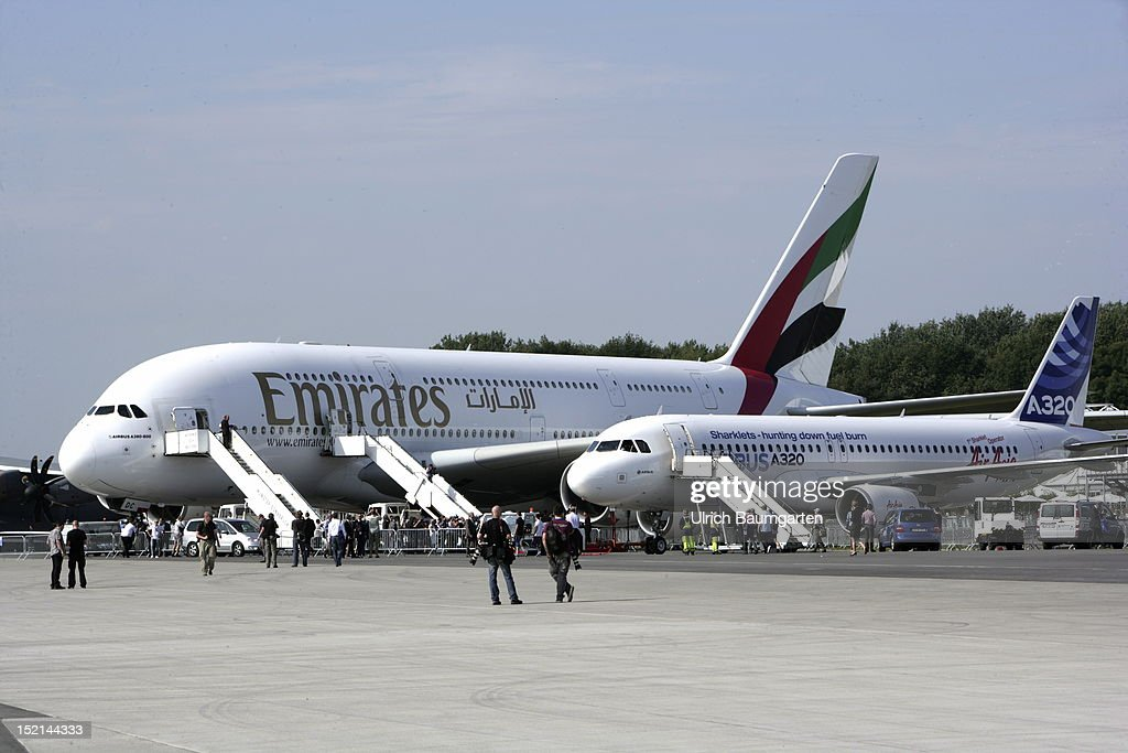 Emirates Airbus A380 and Airbus A320 at the ILA Berlin Air Show on September 11, 2012 in Schoenefeld near Berlin, Germany. The 2012 international air fair runs from September 11 to 16, 2012.