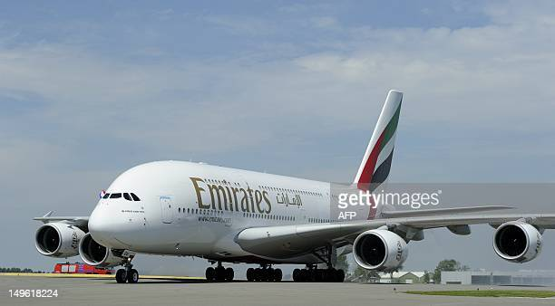 Emirates Airline's Airbus A380 lands for the first time at Schiphol Airport on August 1 2012 The A380 is the largest and heaviest passenger plane in...