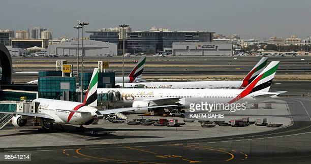 Emirates Airlines planes are parked at the Dubai international airport on April 19 2010 More than 8000 transit passengers have been stranded in the...