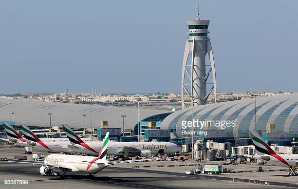Emirates airplanes taxi at the Dubai International Airport in Dubai United Arab Emirates on Tuesday Nov 24 2009 Dubai whose government and stateowned...