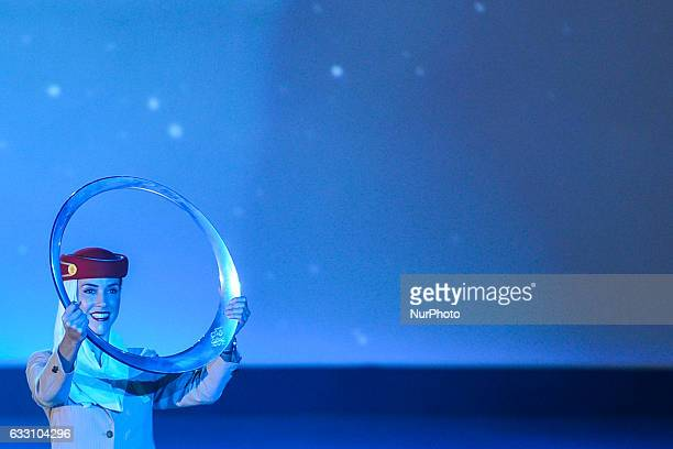 Emirates hostess holds the Trophy 'Circle of Stars' at the Official Opening Ceremony of the 2017 Dubai Tour at the outdoor amphitheatre in the Westin...