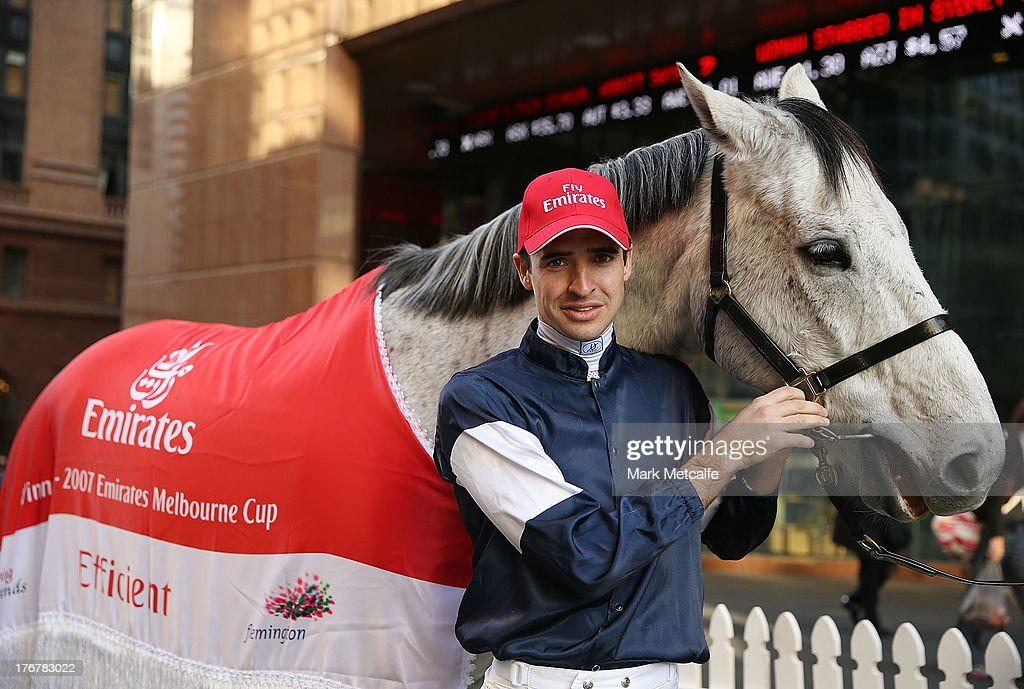 Emirates Melbourne Cup winning horse Efficient and jockey Michael Rodd reunite in Martin Place on August 19, 2013 in Sydney, Australia.