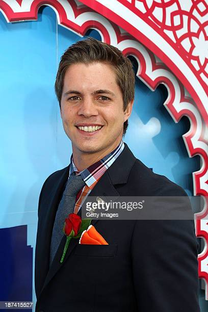 Emirates Stakes Day Fashions on the Field Ambassador Johnny Ruffo poses at the Fashion on the Field enclosure during Emirates Stakes Day at...