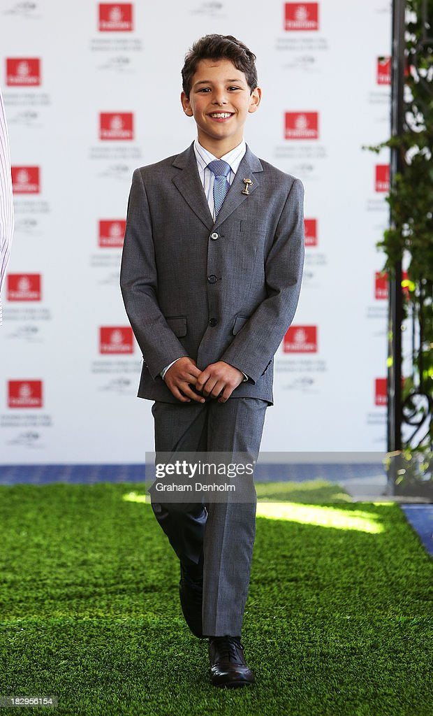 Emirates Stakes Day junior boys face Dario Zannini walks the runway at the Emirates Stakes Day Fashion on the Field Launch at Flemington Racecourse on October 3, 2013 in Melbourne, Australia.