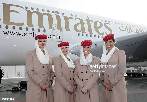 Emirates stewardesses pose in front of the aircraft during the hand over of the A380 to the Emirates airline on January 18 2010 in Hamburg GermanyThe...