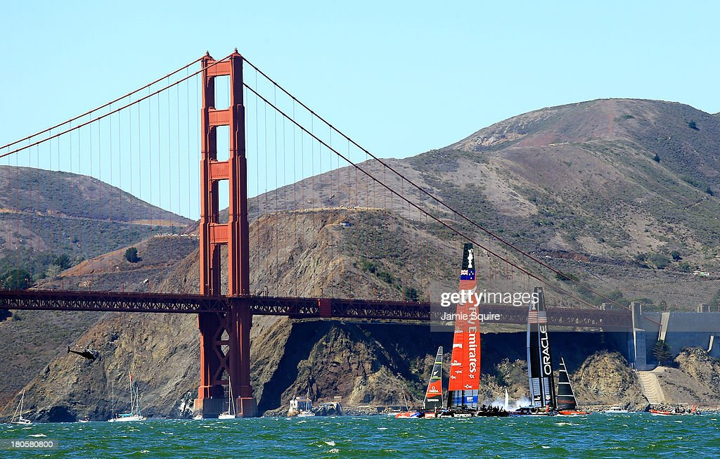 Emirates Team New Zealand and Oracle Team USA practice in front of the Golden Gate Bridge prior to race 8 of the America's Cup Finals on September 14, 2013 in San Francisco, California.