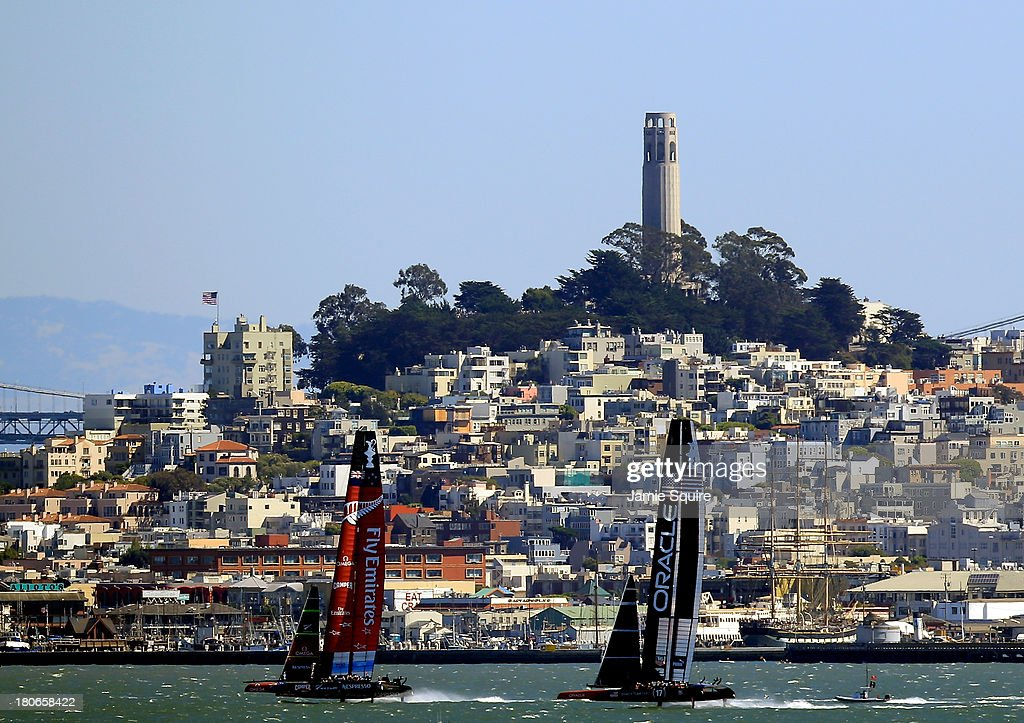 Emirates Team New Zealand and Oracle Team USA race in front of Coit Tower during race 10 of the America's Cup finals on September 15, 2013 in San Francisco, California.
