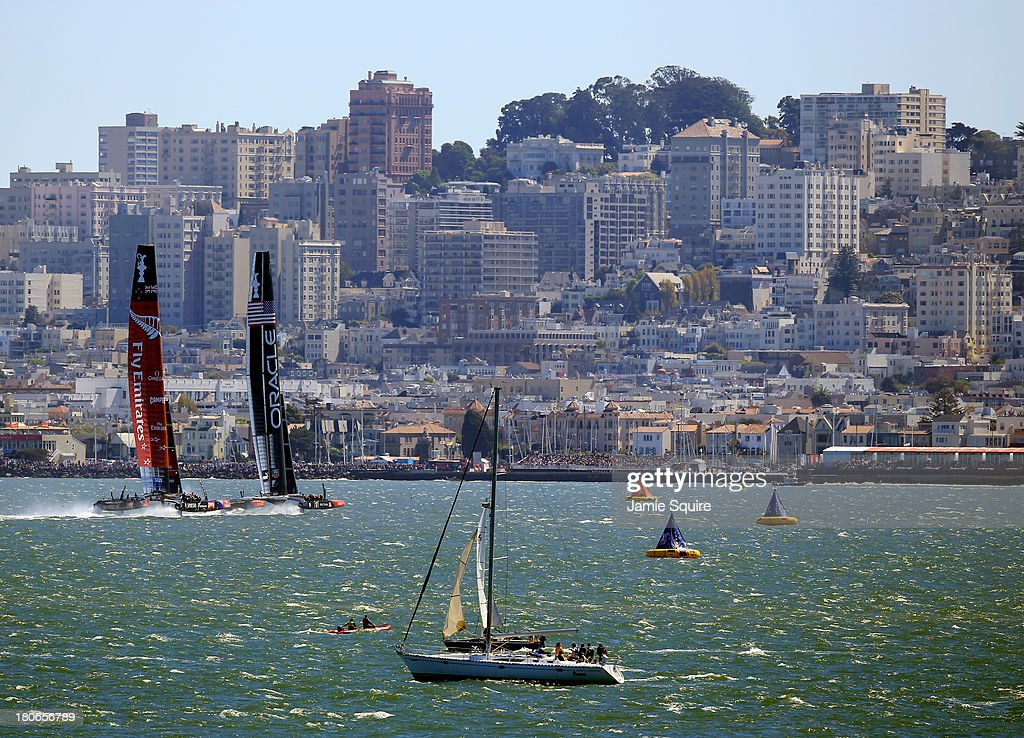 Emirates Team New Zealand and Oracle Team USA race in front of the San Francisco Skyline during race 10 of the America's Cup finals on September 15, 2013 in San Francisco, California.