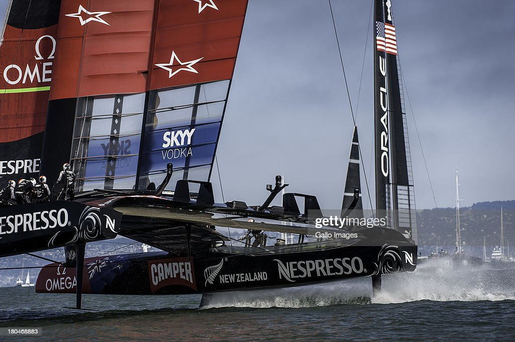 Emirates Team New Zealand bow ahead of ORACLE TEAM USA during day 4 of the America's Cup on September 12th, 2013 in San Francisco.