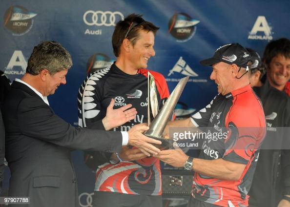 Emirates Team New Zealand CEO Grant Dalton and Skipper Dean Barker are presented with the trophy by Louis Vuitton CEO Yves Carsell at the trophy...