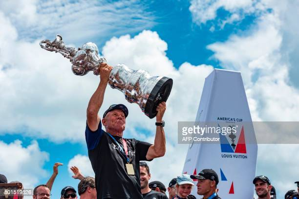 Emirates Team New Zealand CEO Grant Dalton hoists the trophy after his team won the America's Cup in Hamilton Bermuda June 26 2017 / AFP PHOTO /...