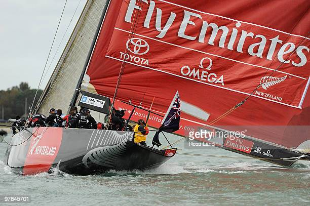 Emirates Team New Zealand crew drop their boom in the water as they round a mark against Azzura of Italy during match two of the Louis Vuitton Trophy...