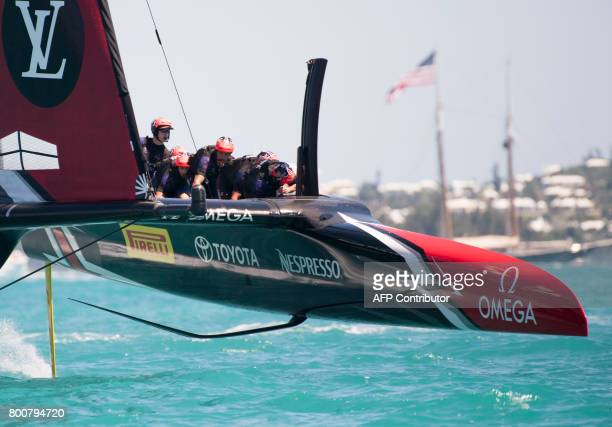TOPSHOT Emirates Team New Zealand crosses the finish line of the second race of the day against Oracle Team USA in the Great Sound during the 35th...