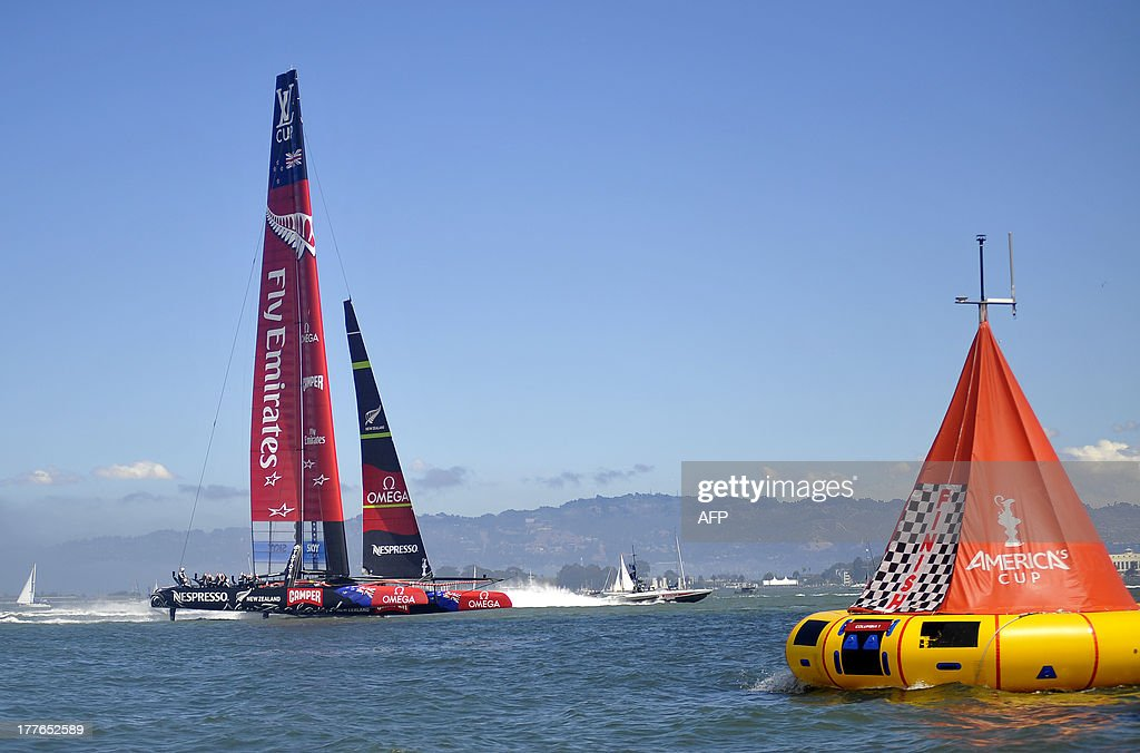 Emirates Team New Zealand dashes to the finish line to win the Louis Vuitton Cup series in the eighth and final race against Luna Rossa Challenge in San Francisco, California on August 25, 2013. AFP PHOTO / Josh Edelson