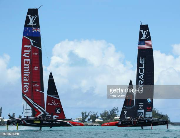 Emirates Team New Zealand helmed by Peter Burling and Oracle Team USA skippered by Jimmy Spithill compete during day 5 of the America's Cup Match...