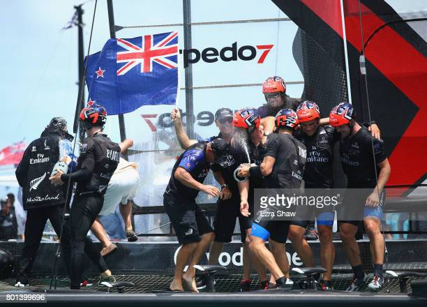 Emirates Team New Zealand helmed by Peter Burling celebrate after winning the America's Cup Match Presented by Louis Vuitton on June 26 2017 in...