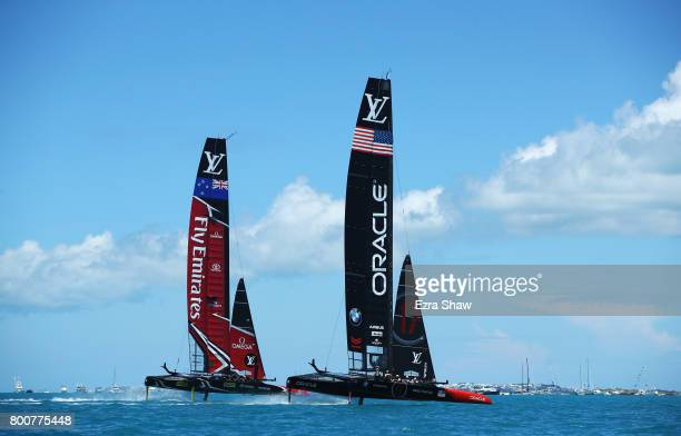 Emirates Team New Zealand helmed by Peter Burling competes with Oracle Team USA skippered by Jimmy Spithill on day 4 of the America's Cup Match...