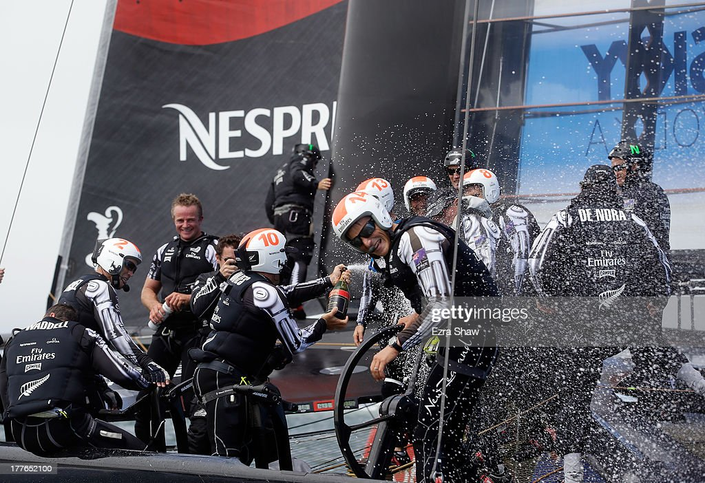 Emirates Team New Zealand including skipper by <a gi-track='captionPersonalityLinkClicked' href=/galleries/search?phrase=Dean+Barker&family=editorial&specificpeople=636929 ng-click='$event.stopPropagation()'>Dean Barker</a> (center) celebrates after they beat Team Luna Rossa Challenge in race eight to win the Louis Vuitton Cup finals on August 25, 2013 in San Francisco, California. Emirates Team New Zealand won the Louis Vuitton Cup 7-1 and will now race against Oracle Team USA in the America's Cup Finals that start on September 7.