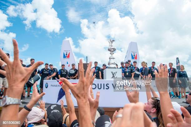TOPSHOT Emirates Team New Zealand on stage moments before being presented with the America's Cup America's Cup in the Great Sound during the 35th...