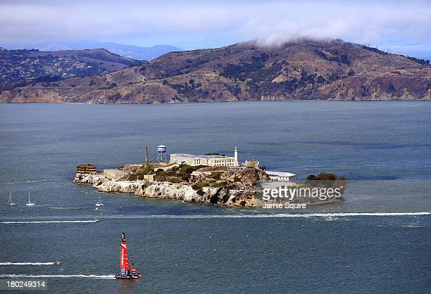 Emirates Team New Zealand passes in front of Alcatraz Island during race 5 of the America's Cup Finals against Oracle Team USA on September 10 2013...