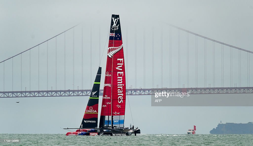 Emirates Team New Zealand passes the Golden Gate Bridge while practicing for the America's Cup on on Thursday, July 11, 2013, in San Francisco. AFP PHOTO/NOAH BERGER