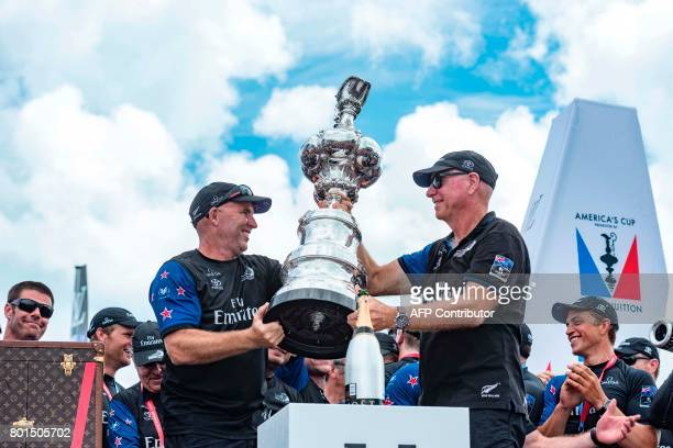 Emirates Team New Zealand performance coach Ray Davies and Sir Stephen Tindall with the America's Cup in the Great Sound during the 35th America's...