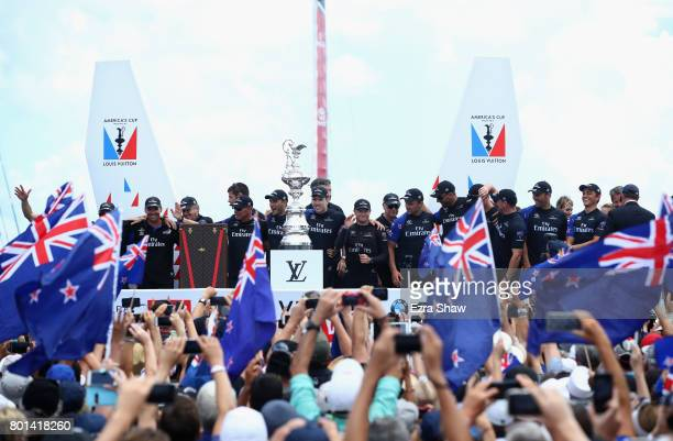 Emirates Team New Zealand prepare to receive the 'Auld Mug' trophy after winning the America's Cup Match Presented by Louis Vuitton on June 26 2017...