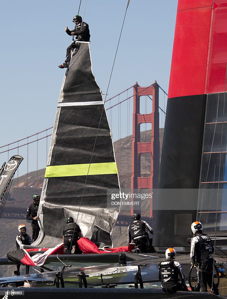 Emirates Team New Zealand prepares for the second race of the day with a sail change during the 34th America's Cup September 19, 2013 in San Francisco. Team USA won the first race of the day and the second was postponed due to high winds. AFP PHOTO/Don Emmert
