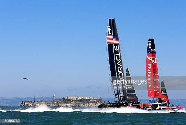 Emirates Team New Zealand races alongside Oracle Team USA as they pass Alcatraz Island during race 8 of the America's Cup Finals on September 14 2013...