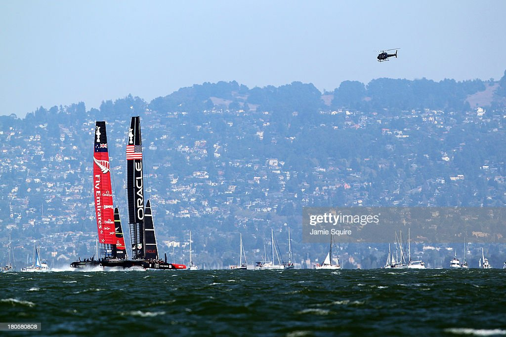 Emirates Team New Zealand races alongside Oracle Team USA during race 8 of the America's Cup Finals on September 14, 2013 in San Francisco, California.