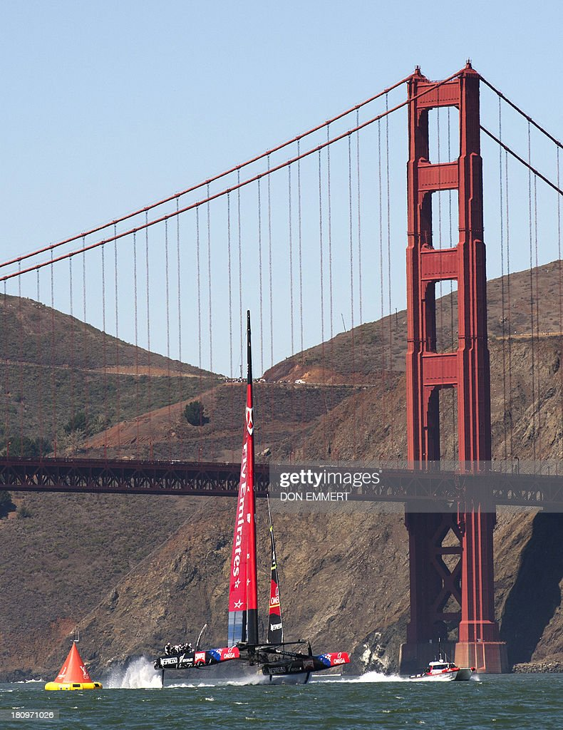 Emirates Team New Zealand races near the Golden Gate Bridge during the first race of the day during the 34th America's Cup September 18, 2013 in San Francisco. Team New Zealand won the first race of the day and the second race was postponed due to high winds. AFP PHOTO/Don Emmert