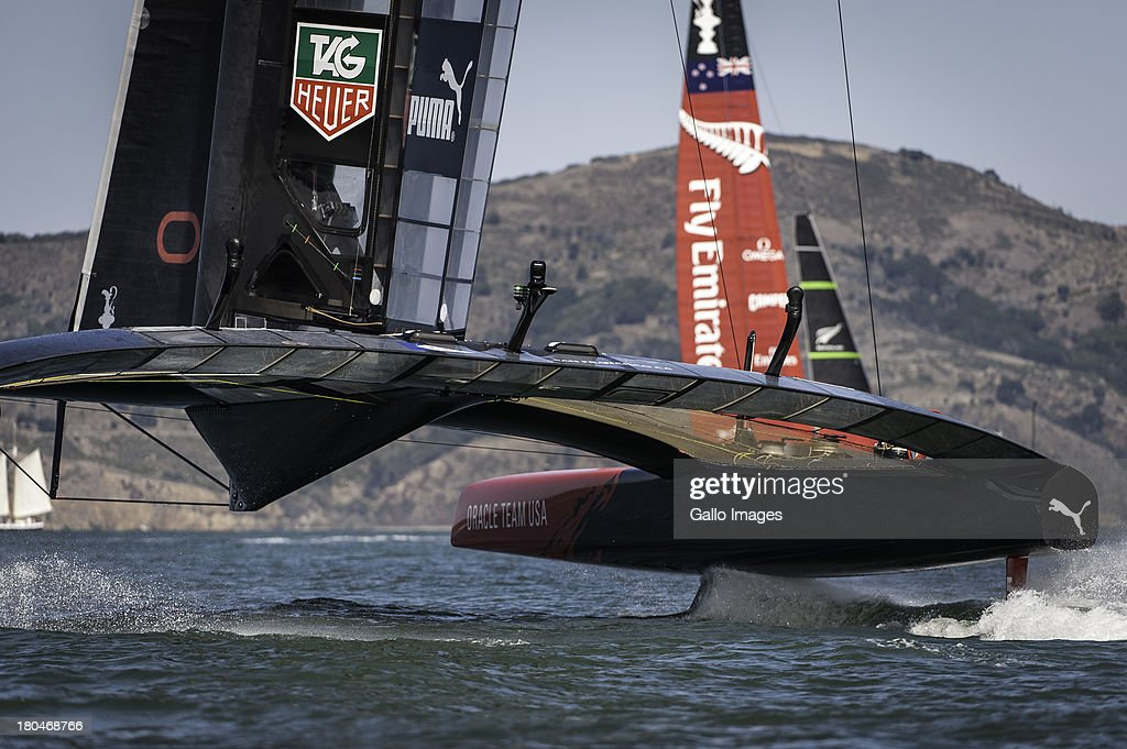 Emirates Team New Zealand rounds the top mark ahead of ORACLE TEAM USA during day 4 of the America's Cup on September 12th, 2013 in San Francisco.