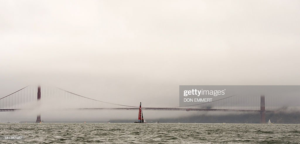 Emirates Team New Zealand sails near the Golden Gate Bridge as they prepare to race against Oracle Team USA during the 34th America's Cup September 20, 2013 in San Francisco. After the first race of the day was over the time limit Oracle won the second race of the day. AFP PHOTO/Don Emmert