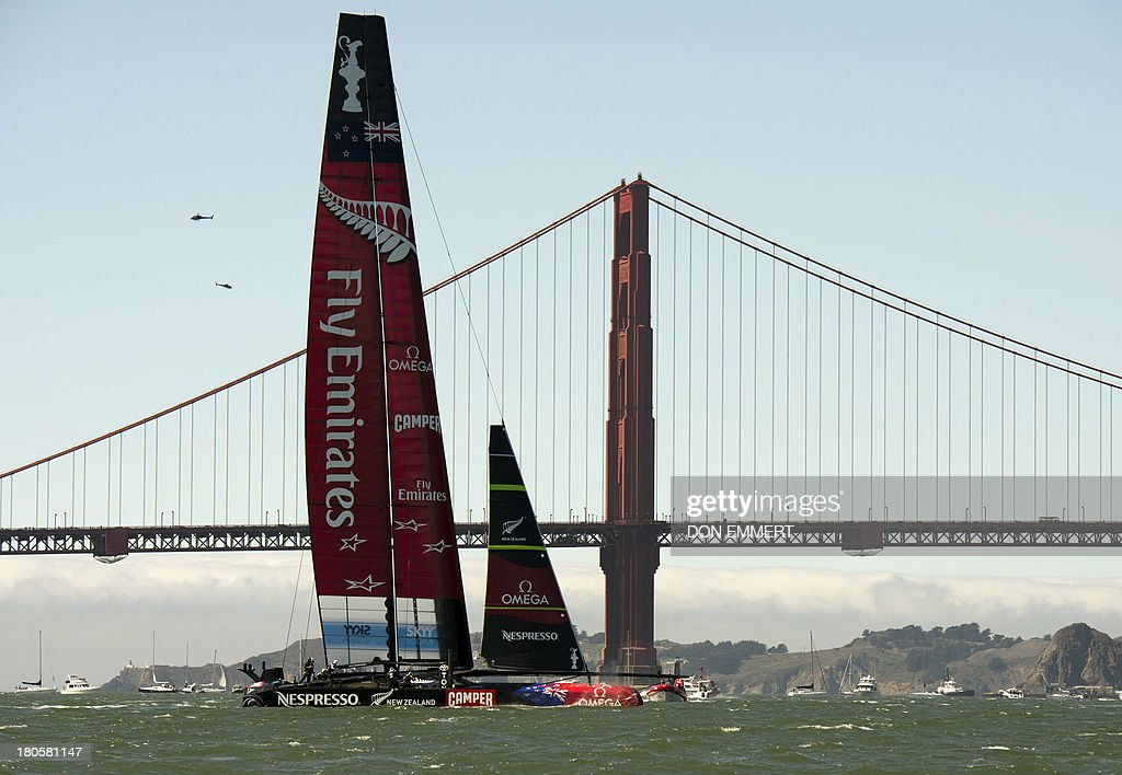 Emirates Team New Zealand sails near the Golden gate Bridge during the 34th America's Cup September 14, 2013 in San Francisco. AFP PHOTO/Don Emmert