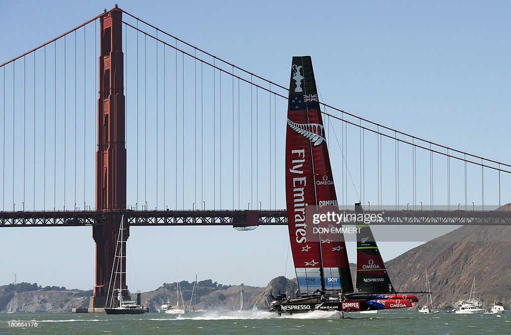 Emirates Team New Zealand sails near the Golden Gate Bridge during the 34th America's Cup September 15, 2013 in San Francisco. The two teams split the races 1-1. AFP PHOTO/Don Emmert