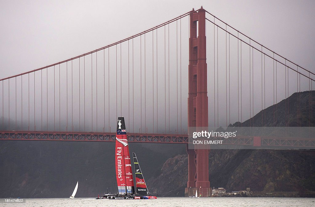 Emirates Team New Zealand sails near the Golden Gate Bridge during the 34th America's Cup September 21, 2013 in San Francisco. Racing was postponed because of unstable wind conditions. AFP PHOTO/Don Emmert