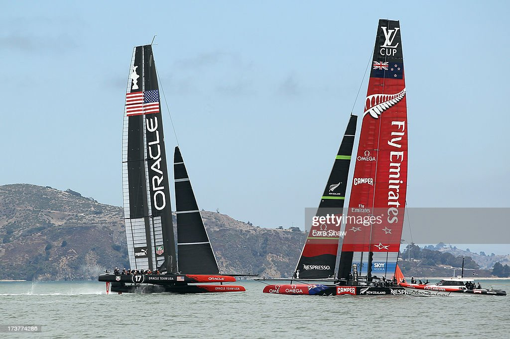 Emirates Team New Zealand sails past Oracle Team USA while training for the America's Cup sailing event on July 17, 2013 in San Francisco, California. Emirates Team New Zealand is currently competing in the Louis Vuitton Cup. The winner of the Louis Vuitton Cup goes on to race against Oracle Team USA in the America's Cup Finals that start on September 7.