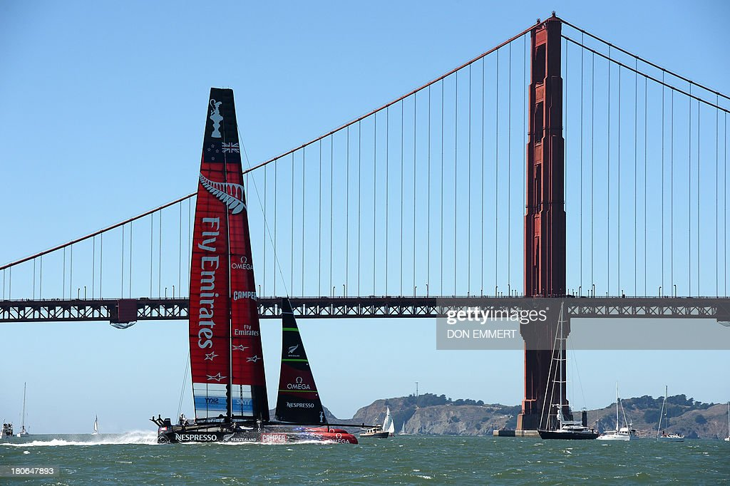 Emirates Team New Zealand sails past the Golden Gate Bridge as it competes against Oracle Team USA during the 34th America's Cup on September 15, 2013 in San Francisco. AFP PHOTO/Don Emmert