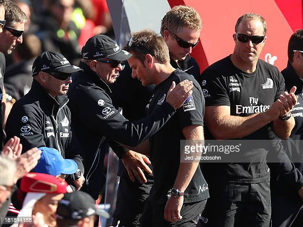 Emirates Team New Zealand skipper Dean Barker looks on with managing director Grant Dalton after losing to Oracle Team USA skippered by James...