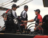 Emirates Team New Zealand Skipper Dean Barker shakes hands with CEO Grant Dalton after they crossed the line ahead of Mascalzone Latino Audi Team...