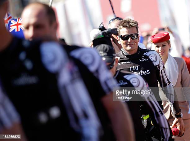 Emirates Team New Zealand skipper Dean Barker walks onto the stage for the dockout show before going out to race against Oracle Team USA in race 14...