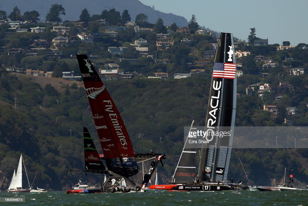 Emirates Team New Zealand skippered by Dean Barker almost capsizes while racing against Oracle Team USA skippered by James Spithill during race eight...