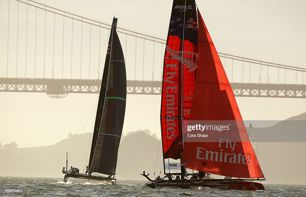 Emirates Team New Zealand skippered by Dean Barker and Oracle Team USA skippered by James Spithill compete in the sixth fleet race of the America's Cup World Series on October 5, 2012 in San Francisco, California. Teams are racing on an AC45 boat, which is the forerunner to the AC72 that teams will race next year in the Louis Vuitton Cup and America's Cup Finals in San Francisco. Olympic swimmer Natalie Coughlin was the guest racer on the Emirates boat during this race.